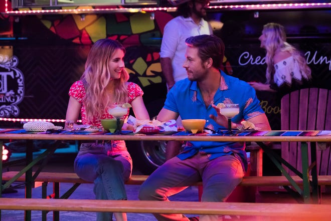 "This image released by Netflix shows Emma Roberts and Luke Bracey, right, in a scene from ""Holidate."""