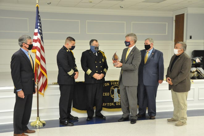 At the presentation of the Paul Sarbanes National Firefighter Safety Award to the Clayton Fire Company Oct. 28 are, from left, Gov. John Carney, Clayton Fire Chief Alex Carrow, Fire Company President Kevin Wilson, William Webb, executive director of the Congressional Fire Services Institute; Steve Austin, past director of the Delaware Volunteer Firefighters Association, and Ron Siarnicki, executive director of the National Fallen Firefighters Foundation.