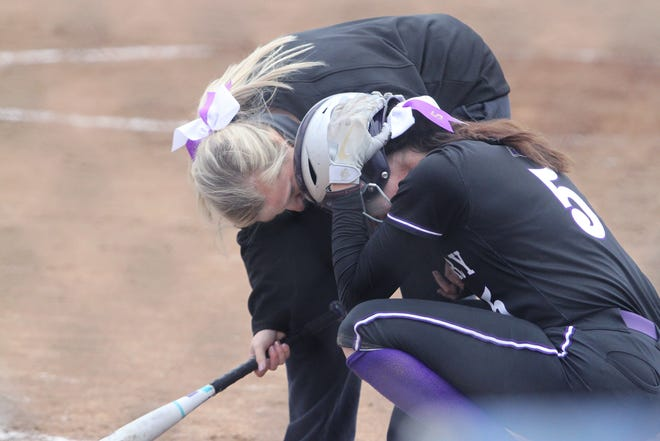 Salisbury senior Brooke Bartholomew is consoled by Lady Panthers assistant softball coach Sidney Cook as Bartholomew crouches down in agony after striking out for the third out that ended the 2020 MSHSAA Class 1 state semifinal game Wednesday. Bartholomew smacked a solo home run in the bottom of the sixth inning to give her team a 1-run lead, but Vienna hit a pair of homers in the seventh to defeat the defending state champions by a 5-4 score.