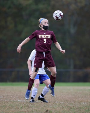 Caiden Ibbotson (5) and the Tiverton boys soccer team welcomes Rogers on Saturday.