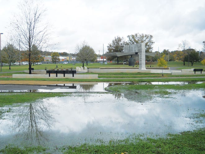 Water gathered mid-day Thursday near the International Friendship Bell and Peace Pavilion at A.K. Bissell Park following Wednesday and Thursday's rainfall.