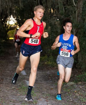 Belleview's Luis Cruzado stayed as one of the leaders along with Vanguard's Joshua Moore during the boys' race in the Class 3A, District 5 cross country meet Wednesday afternoon.