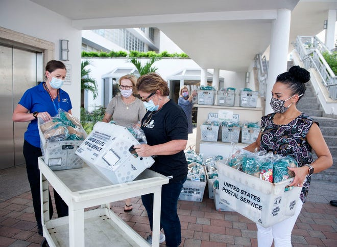 The Town of Palm Beach United Way on Wednesday delivered 300 care packages to employees at Good Samaritan Medical Center in West Palm Beach. (MEGHAN MCCARTHY/PALM BEACH DAILY NEWS)