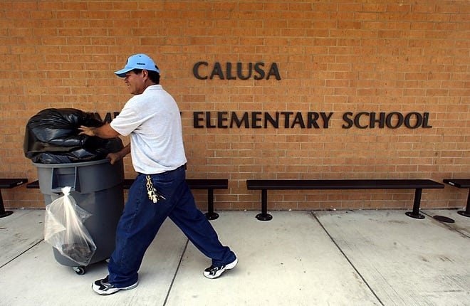 A janitor works at Calusa Elementary in Boca Raton in 2004. [Palm Beach Post file photo]