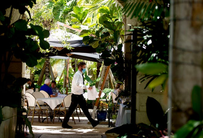 Cafe Via Flora, a favorite lunch spot within the Worth Avenue vias, offers al fresco dining in a leafy setting.