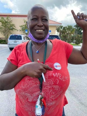 """Carol """"Tee"""" Burgess points to her """"I Voted"""" sticker during the August state primary election in Belle Glade. It was the first time Burgess, who had her rights restored under Amendment 4, had voted in more than two decades due to felony convictions."""