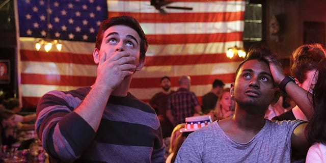 Supporters of presidential candidate Hillary Clinton watch televised coverage of the U.S. presidential election at Comet Tavern in the Capitol Hill neighborhood of Seattle on Nov. 8. [Photo by Jason Redmond/AFP/Getty Images]