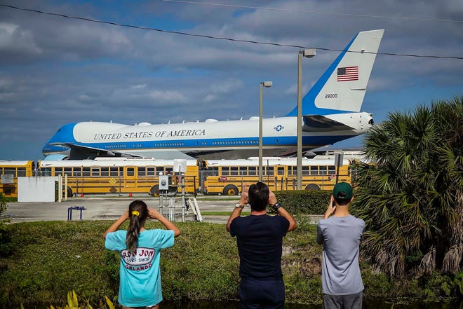 People take photos of Air Force One as it sits at Palm Beach International Airport during President Donald Trump's stay in this photo from November 2019 in West Palm Beach.