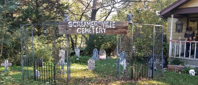 Christopher and Jennifer Wicks of Enon dug up their totes filled with skeletons, ghosts, pumpkins, black cats, scarecrows, gargoyles, tombstones, witches, and ravens to decorate for Halloween of 2020.