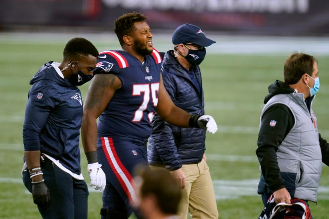 New England Patriots offensive lineman Justin Herron leaves the field after sustaining an injury in the second half of an NFL football game against the San Francisco 49ers, Sunday, Oct. 25, 2020, in Foxborough, Mass.