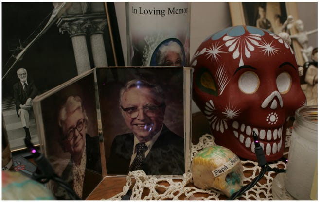 Marta Martinez's altar to remember the deceased in 2009 included a photo of her in-laws, Mary and Joseph Youngs.