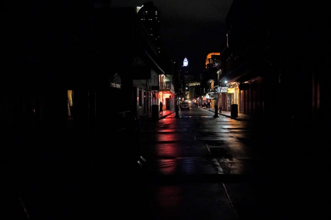 A small stretch of Bourbon Street that has power is seen from an otherwise darkened French Quarter in New Orleans, Wednesday, Oct. 28, 2020. Hurricane Zeta passed through today leaving much of the city and metro area without power. (AP Photo/Gerald Herbert)