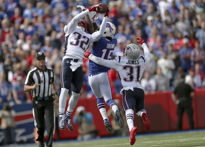 Patriots safety Devin McCourty intercepts a pass intended for Buffalo wide receiver John Brown last September in Orchard Park, N.Y.