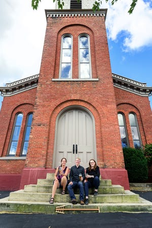 Issue 32 on November's ballot will give voters the choice whether or not to permit Sunday liquor sales at the upcoming Belltower Brewing Company. Pictured are business frontrunners Jennifer Hermann (left), Ryan Tipton and Bridget Tipton.  Photo courtesy of Stephen Mulé of Stephen Mulé Photography