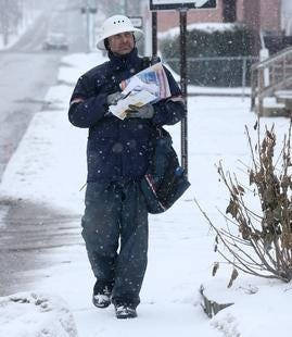 Rich Henderson of the United States Postal Service delivers mail on 25th Street NW in Canton as a winter storm moved through the region Saturday, Jan. 19, 2019. (CantonRep.com / Scott Heckel)