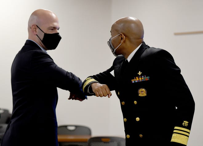 US Surgeon General Jerome Adams greets  U.S. Representative Anthony Gonzales before a roundtable health leaders from Mercy Medical Center and virtually from Aultman to learn more about the effects of the COVID-19 crisis locally. Thursday, October 29, 2020.