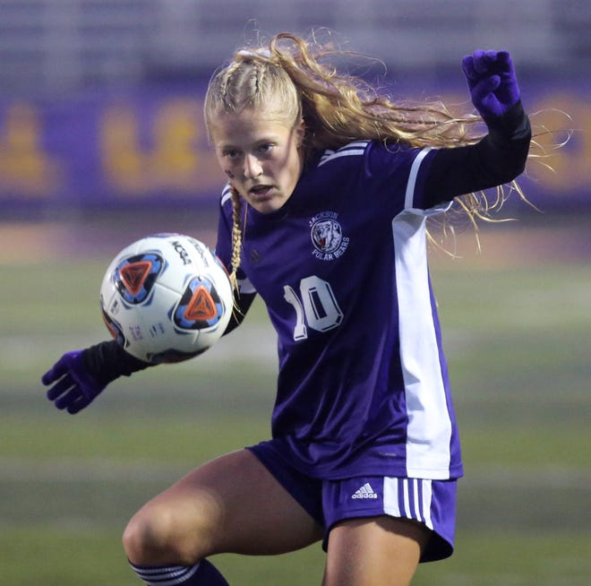 Caitlin Bruni of Jackson keeps an eye on the ball during their Division I district girls soccer final against Mentor at Jackson on Thursday, Oct. 29, 2020.