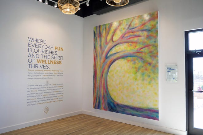 Heartfelt Connection, this art piece at the Wellen Park Welcome Center, pays tribute to Wellen Park's Tree Conservation and Relocation program.