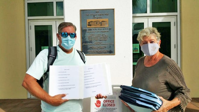 John Meisel of the West Villagers For Responsible Government and Jennifer Zambrano deliver petitions pushing for contraction of the city of North Port on behalf of more than 1,300 qualified voters. It is the second such petition filed in the past four months. This new petition includes all land west of the Myakka River.