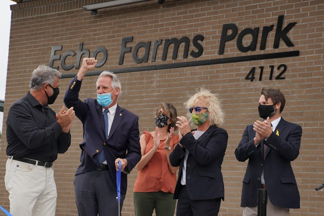Wilmington Mayor Bill Saffo, New Hanover County commissioner Rob Zapple, New Hanover Parks and Gardens Director Tara Duckworth, commissioner Julia Boseman and architect Doug Sherwood cut the ribbon as the city and county held a dedication ceremony for Echo Farms Park on Thursday.