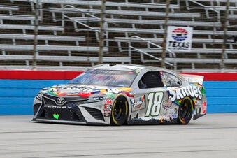 Eventual race winner Kyle Busch drives on the front stretch during Wednesday's NASCAR Cup Series race at Texas Motor Speedway in Fort Worth, Texas.