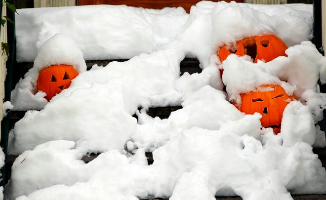 This photo, from Oct. 31, 2011, shows the front steps of a home in Brookfield. Many communities postponed trick-or-treating after heavy snow.
