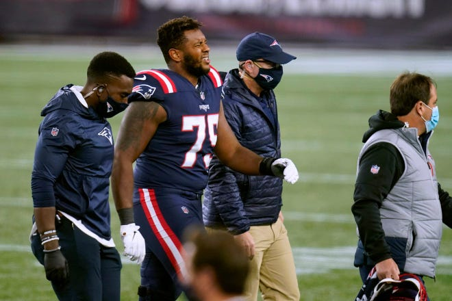 New England offensive lineman Justin Herron leaves the field after sustaining an injury in the second half of last Sunday's game.