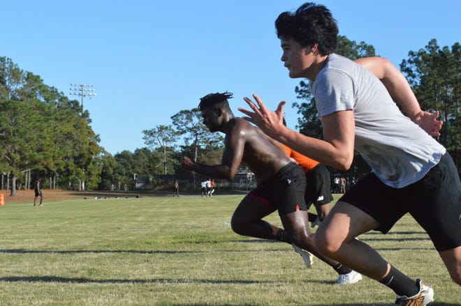 South View senior Donta Autry, center, leads the Tigers in sprints on Monday in the program's second week of workouts.