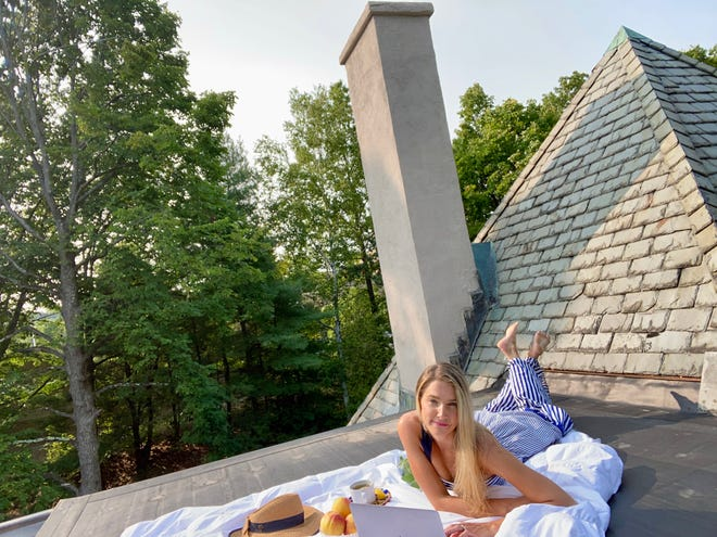 Cottagecore is drinking tea on a slate shingled rooftop in a prairie dress at sunset while listening to folk songs and staring longingly at a bowl full of ripe peaches.