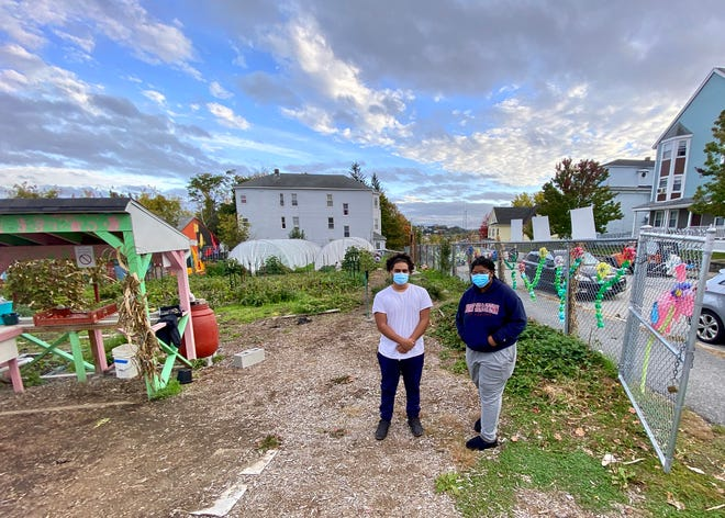 YouthGROW members Christian Carrasquillo and Simone Barjolo in the Regional Environmental Council's urban farm on Oread Street .