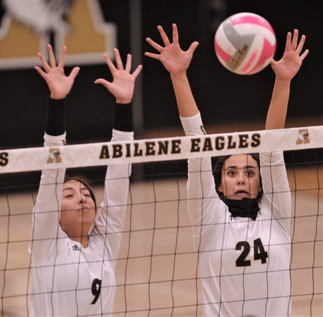 Abilene High's Mia Cairo (24) and Isa Escobedo try to block an Odessa High shot. AHS beat the Lady Bronchos 25-16, 25-18, 22-25, 25-19 in the District 2-6A volleyball match Wednesday, Oct. 28, 2020, at Eagle Gym.