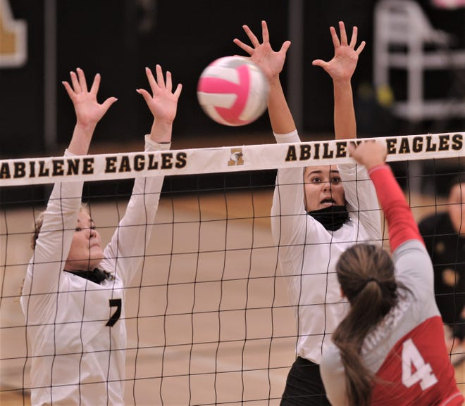 Abilene High's Gentri Anderson, left, and Mia Cairo try to block a shot by Odessa High's Brianna McClure. AHS beat the Lady Bronchos 25-16, 25-18, 22-25, 25-19 in the District 2-6A volleyball match Oct. 28 at Eagle Gym. Both Anderson and Cairo return this season.