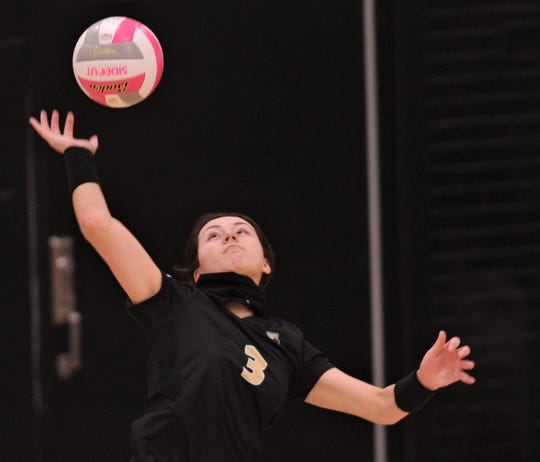 Abilene High's Maddie Perez serves the ball to Odessa High. AHS defeated the Lady Bronchos 25-16, 25-18, 22-25, 25-19 in District 2-6A volleyball on Wednesday at Eagle Gym.