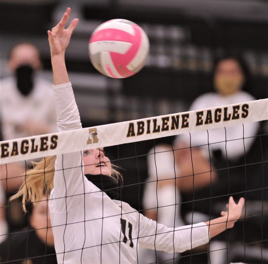 Abilene High's Sarah Cox hits a free ball for a kill in the second set against Odessa High. AHS defeated the Lady Bronchos on Wednesday at Eagle Gym with 25-16, 25-18, 22-25, 25-19 in District 2-6A's volleyball game.
