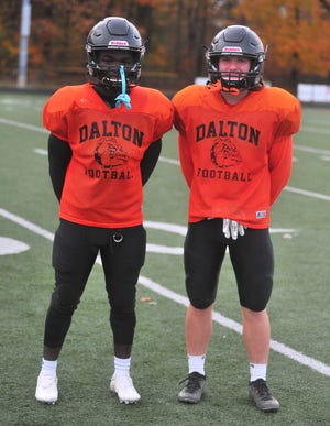 Adam Knetzer (left) leads Dalton in sacks and tackles for loss and Adam Jarrett (right) is the 'Dawgs second-leading rusher heading into their regional semifinal matchup with Warren JFK.