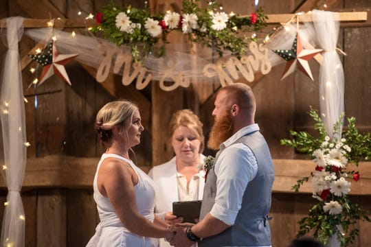 Jessica and David Neiheisel exchange vows at WoodBottom Farms in Bethel on Sunday, Oct. 25, 2020.