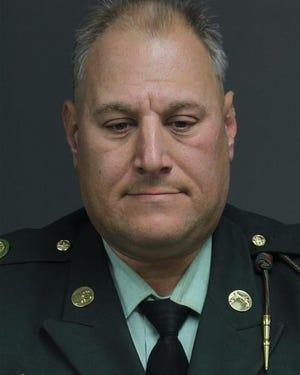 Warren City Councilman Eddie Kabacinski wore a military police uniform to his arraignment.