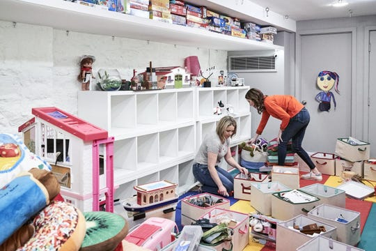 """Clea Shearer, right, and Joanna Teplin tackle an unruly play room in """"Getting Organized with the Home Edit"""" on Netflix."""