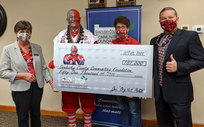 """Sandusky County Communities Foundation's Laurie Young, far left, is joined by Jon """"Big Nut"""" Peters, wife Terese Peters, and foundation board chair Tom Bowlus."""