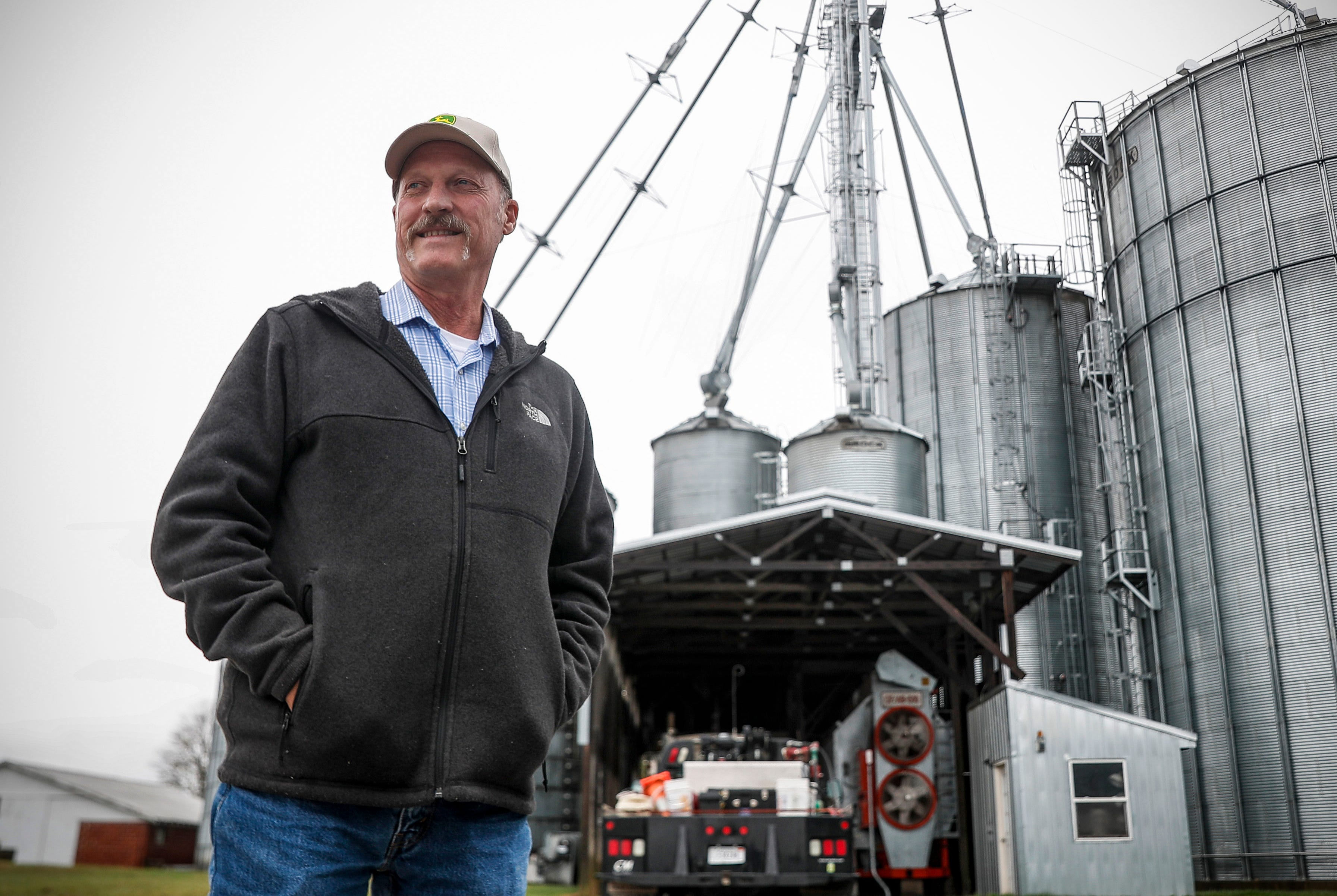 Farmer Brian Thompson stands outside the barns at B&A Thompson Grain Farm in Seymour, Ind., Thursday, October 29, 2020.