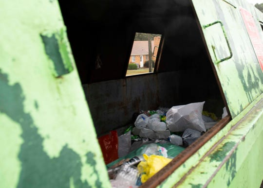 Plastic items are scattered inside the recycling container at one of the recycling sites in Jackson, Tenn., Thursday, Oct. 29, 2020.