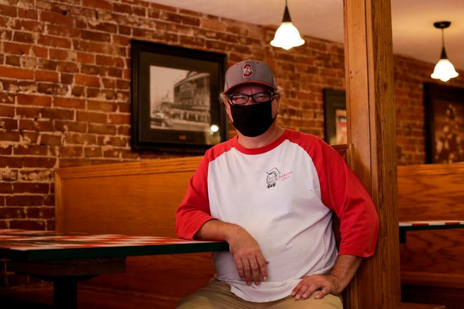 Professor Joe's Pizzeria and Pub owner Joe Wenig sits in a booth inside the Main Street eatery, Wednesday, Oct. 28, 2020 in Lafayette.