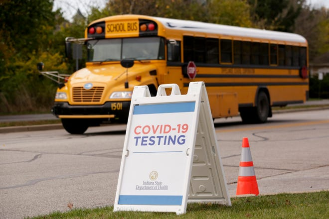 A school bus drives past a COVID-19 Testing Site on Cumberland Avenue, Thursday, Oct. 29, 2020 in West Lafayette.