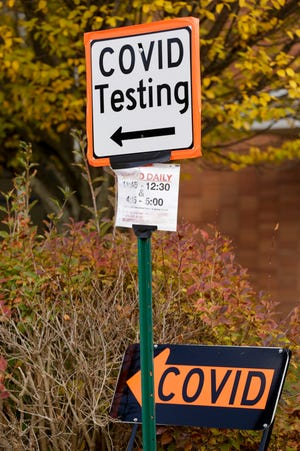 A COVID-19 Testing sign is posted outside Happy Hollow Elementary, Thursday, Oct. 29, 2020 in West Lafayette.