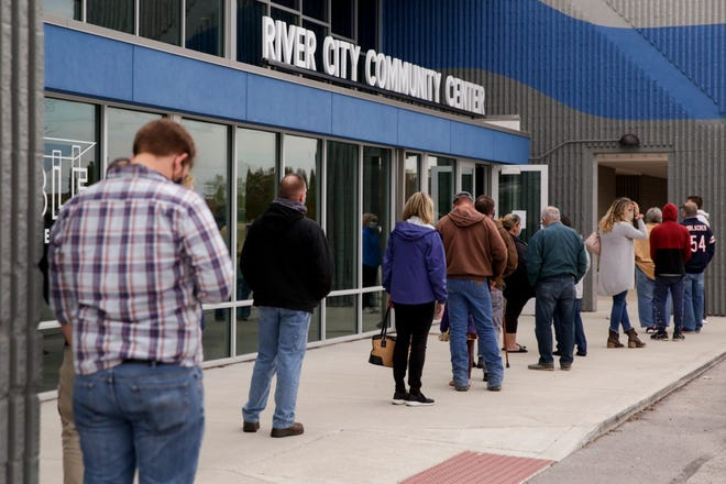 Voters line up outside the River City Community Center satellite polling location, Thursday, Oct. 29, 2020 in Lafayette.