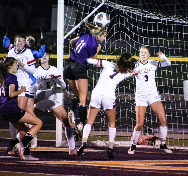 Bloom Carroll sophomore Sophia Haughn attempts to hit the ball into the goal with her head in the second half against Hartley on Wednesday. The Bulldogs fell, 1-0.