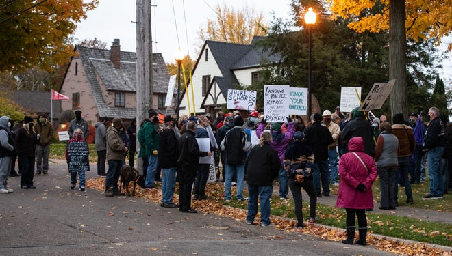 City retirees and supporters rally across the street from Lansing Mayor Andy Schor's home, Thursday, Oct. 29, 2020, protesting changes to their health care benefits.