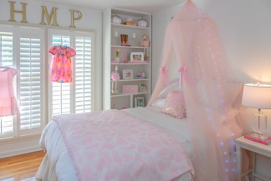 Hattie Mae's bedroom is pretty in pink with a mix of traditional and fantasy decor.