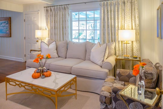 The living room is a soothing symphony ofneutral colors and fabrics.