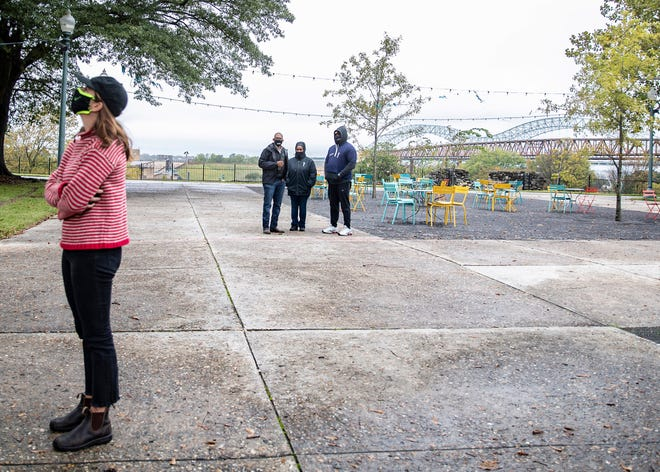 (Left to right) Helen Hope, Dennis Head, Kammie Glenn and Raymond Terry listen to sound installation being played at Fourth Bluff Park at the site of a former monument to Jefferson Davis in Memphis, Tenn., on Friday, October 29, 2020.